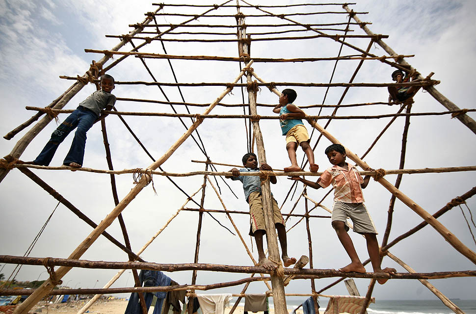 Children climb an exposed bamboo scaffolding at the Marina Beach, Chennai (Photo-Arun Sankar/AP)