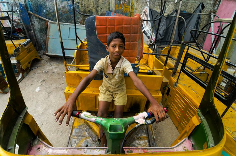 A young boy plays with an abandoned rickshaw (Photo- Rajagopalan Sarangapani) A young boy plays with an abandoned rickshaw (Photo- Rajagopalan Sarangapani)