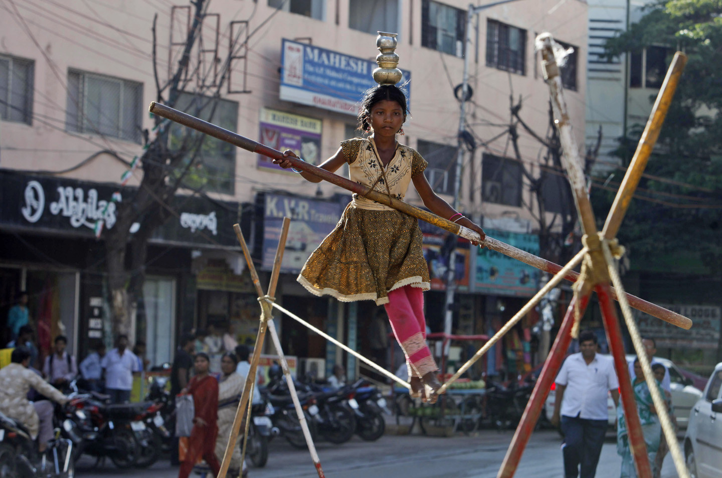 A young girl performs a stunt on a tightrope in the city of Hyderabad (Photo- Mahesh Kumar/Associated Press)
