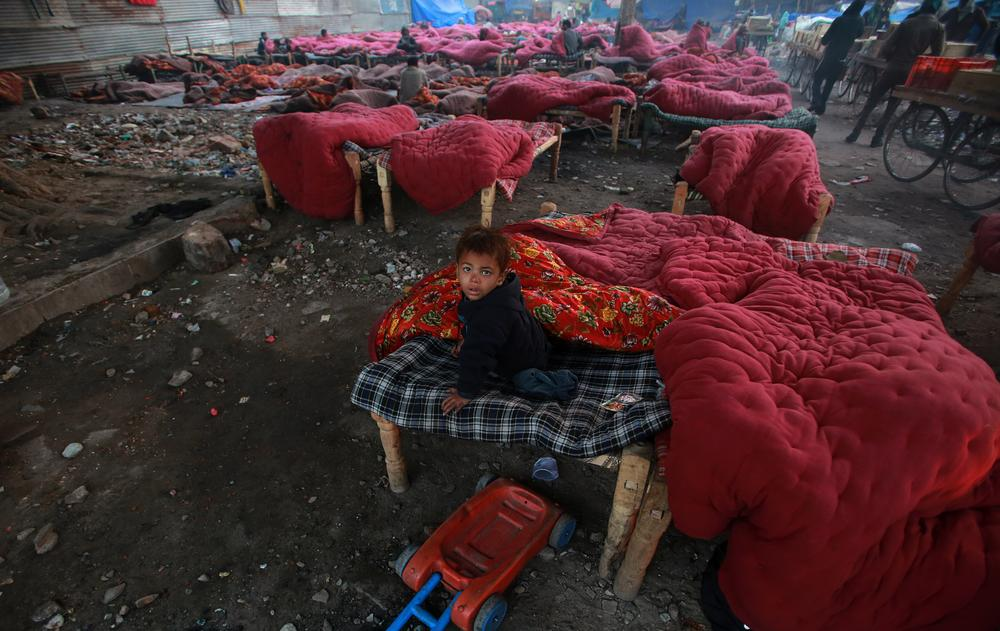 A temporary shelter home in New Delhi (Photo: Money Sharma/EPA)