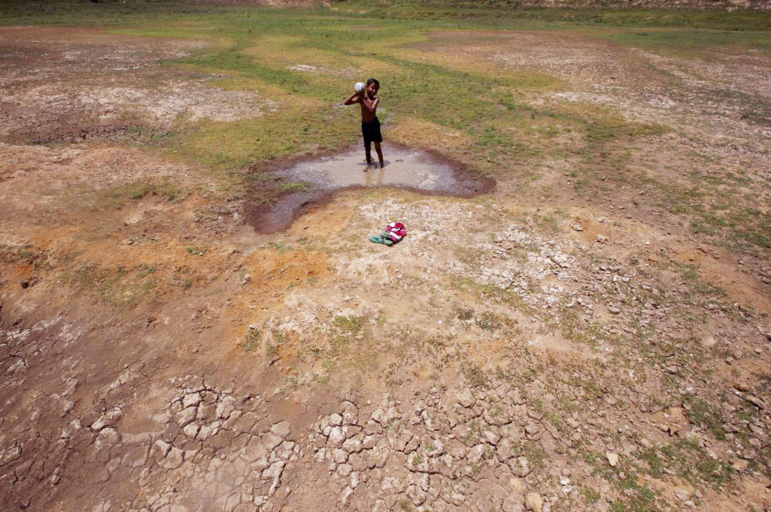 A village boy bathes in the remaining water of a dried pond to beat the heat in the outskirts of Bhubaneswar (Photo: Biswaranjan Rout/NurPhoto/Getty Images)