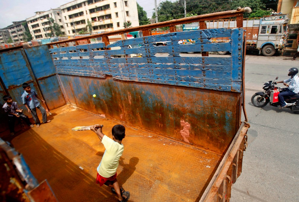 Children play cricket in the back of a truck in Mumbai (Photo- Unknown)