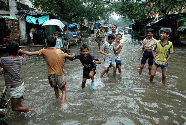 Children take to the flooded streets of Kolkata during play-time (Photo- KPA/Zuma /Rex features)