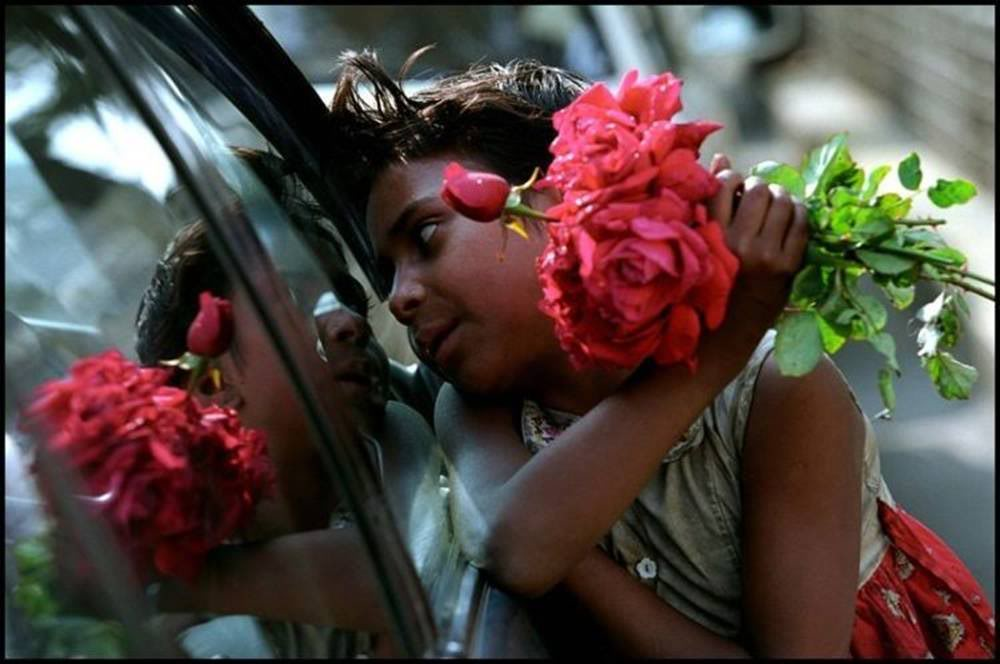 Selling flowers at traffic signals in urban cities (Photo- Unknown)