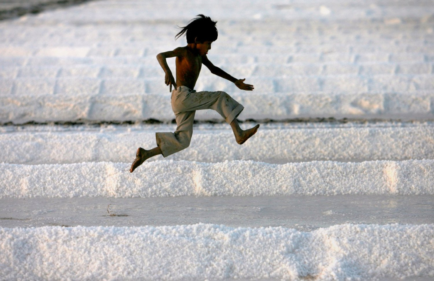 A child catapults across the salt pans of Kutch (Photo- Reuters)