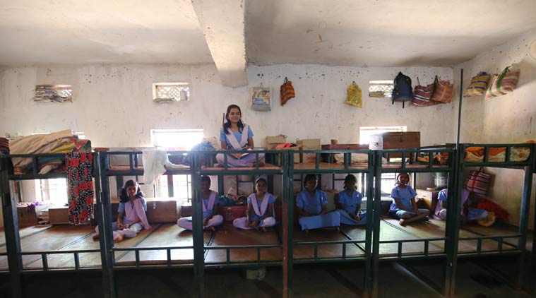 "With an annual pass percentage of 100, the Korchamal residential school is one of the schools the district administration holds up as a success model. Rashmita Harijan, on the bunk bed, has been in this school since she was eight years old and calls it her ""home"" (Photo:Ravi Kanojia)"