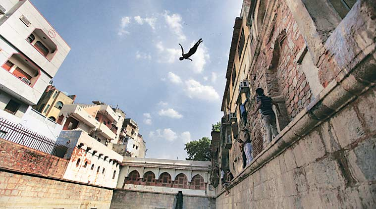 A boy jumps into a baoli at Nizamuddin Dargah in Delhi (Photo: Ravi Kanojia)